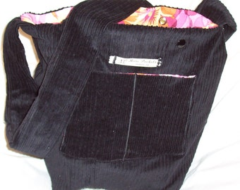 The Jeff Field Bag in wide wale black corduroy fabric with a bright pink and orange floral print cotton lining