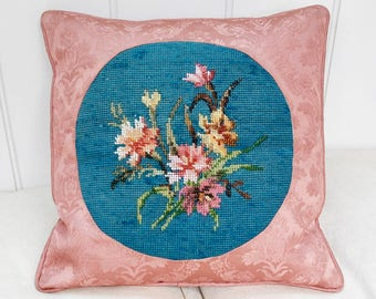 An antique floral beadwork and needlepoint cushion