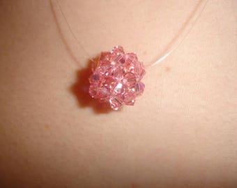 Swarovski rose pendant.