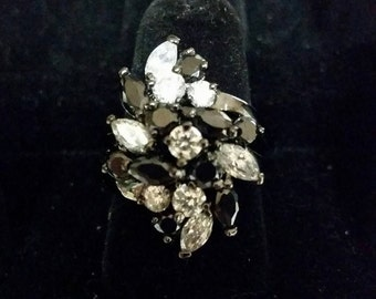 Black metal ring with black and white stones