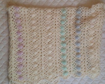 "Soft white baby blanket, with touches of color  44""x40"""