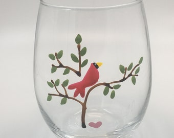 Cardinal in tree with small heart