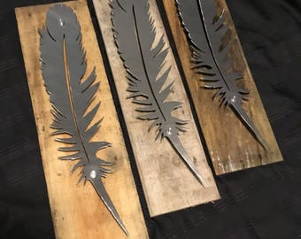 Metal Feather Mounted to Wood