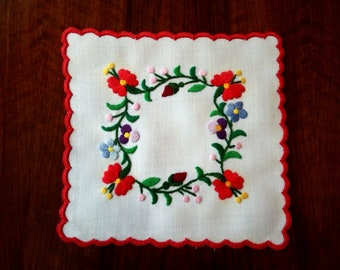 """Hand made 6"""" floral doily, embroidered tabletop."""