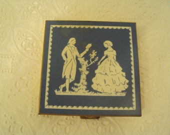 Volupte Ladies compact, 1940-1950's, Wedgewood blue cover with gentleman reading to lady