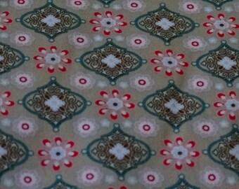 Geometric patterns on beige background cotton fabric