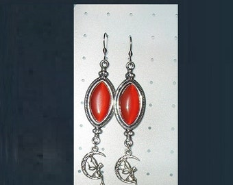 pretty pair of earrings with cabochon cat's eye and fairy pendant