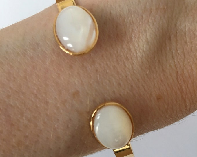 Gemstone bracelet, bangle bracelet with a 24 karat gold finish and mother of pearl semi precious stone