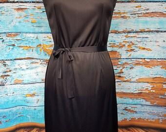 Classic 60s black ruffled dress.