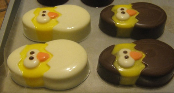 One dozen chick popping out of an egg chocolate covered sandwich cookie