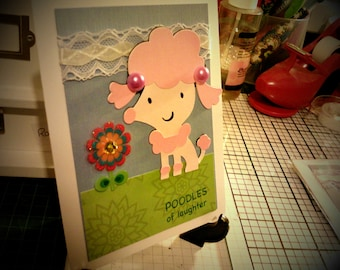 Pink poodles of laughter greeting card
