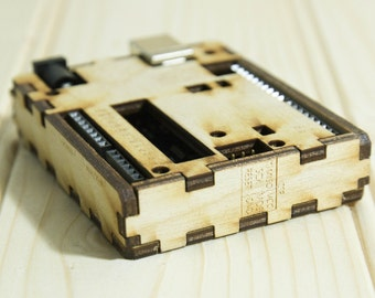 Laser cut arduino uno wood case made from birch ply. Custom logo