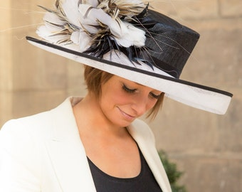 Formal hat with feather trim perfect for weddings or the races