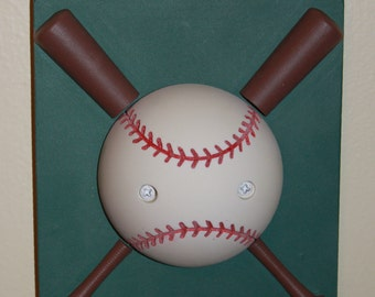 baseball light switch cover with rotating ball