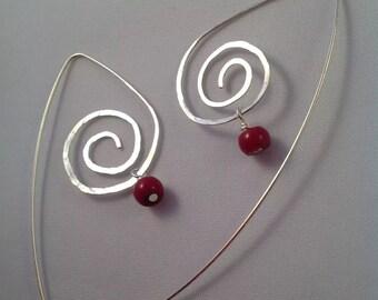 Contemporary long swirl earrings