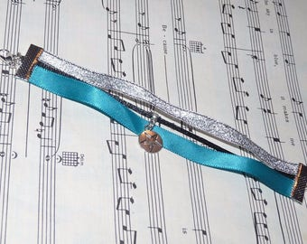 Bracelet/silver and turquoise satin ribbon and glitter star charm