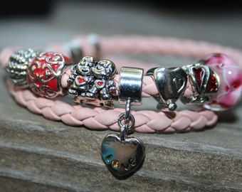 Hand braided indian pink leather bracelet, European style charm, pugster charm, bolo bracelet, pink, double wraps, magnetic clasp
