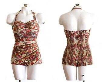 1950s halter top bathing suit in brown Hawaiian/tiki print