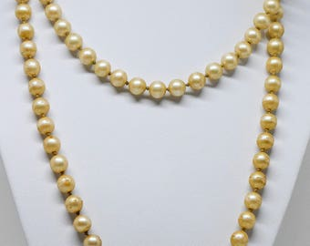 Lovely gold tone faux pearl necklace