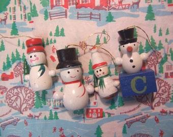 four fun little snowmen