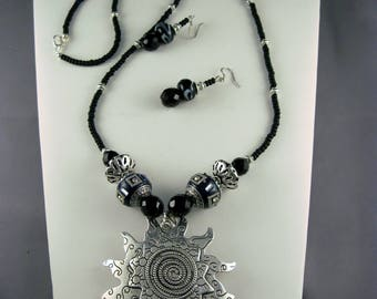 Spectacular Silver Sunburst Pendant with Black and Silver Accent Beads