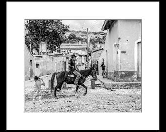 Framed Cuba Mono Photograph of a man on horse in Trinidad