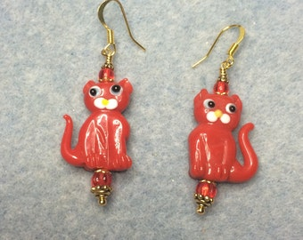 Opaque red lampwork cat bead earrings adorned with red Czech glass beads.