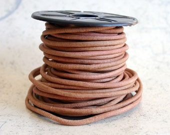 1 meter of 6mm Natural Tan Distressed Round Leather Cord