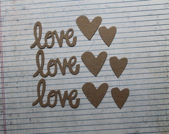 "3 Bare chipboard die cuts ""love"" word with 6 heart accents"