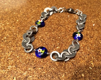 Hardware jewelry bracelet with stainless steel washers and flower glass beads