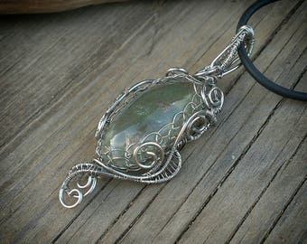Wire wrap pendant with aqua quartz