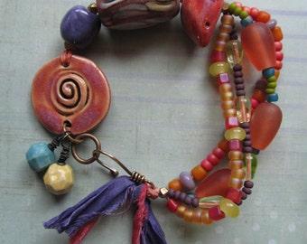 Orange, Pink and Purple Multi Strand Bird Artisan Bracelet