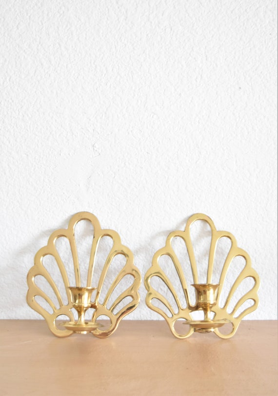 hollywood regency pair of brass seashell wall hanging candlestick holders / shell