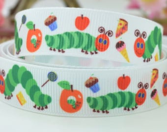 Adorable white  100%  polyester grosgrain ribbon with colourful hungry catapillar and food design.