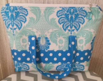 Cute blue and pale teal cosmetic bag.