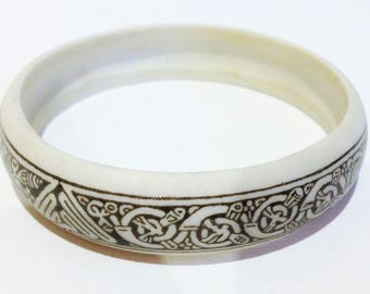 Bangle - stone feel composite white cream bangle with celtic knot work pattern