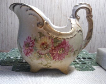 Antique hand-painted creamer with gold accent