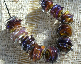 lampwork/sra lampwork/beads/lampwork beads/nuggets/striking glass/swirl/spiral/colorful