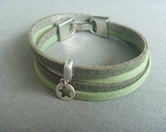 Wrapbracelet of denim cord , leather and a star