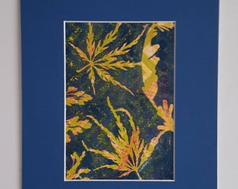 If drama is what you want, this 8 x 10 blue matted gelli print of leaves in dynamic oranges, greens, reds, & blues is exactly what you need.