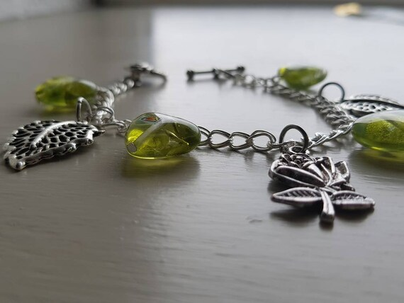Green leaf bracelet with rose charm