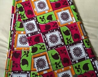 Beautiful African fabric, orange green and cream swirls African wax print cotton fabric