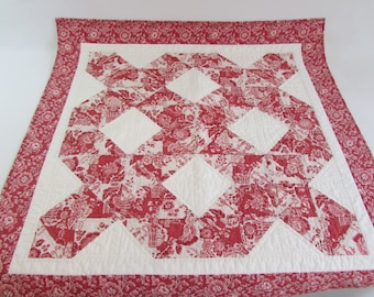 Quilted Square Table Topper in faded red and cream brings adds traditional colors to your home