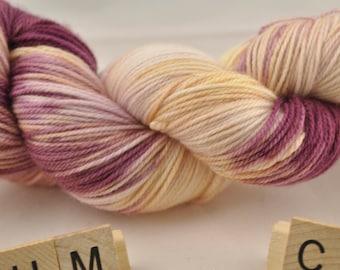 "Hand-dyed yarn, ""Plum Champagne"" variegated, soft and squishy yarn. Great for socks or shawls. 80/20 Superwash wool/Nylon"