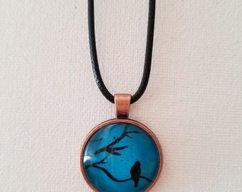 Turquoise bird silhouette pendant