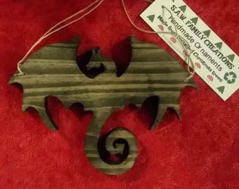 Handmade wooden ornament made from a recycled Christmas tree dragon