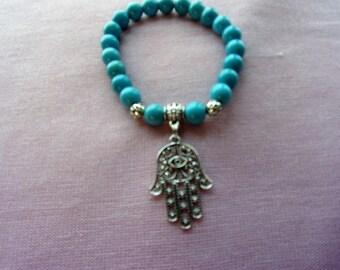 Turqouise Magnesite stretch bracelet with Hamsa Hand charm