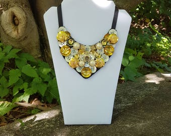 Ivory and gold button bib necklace