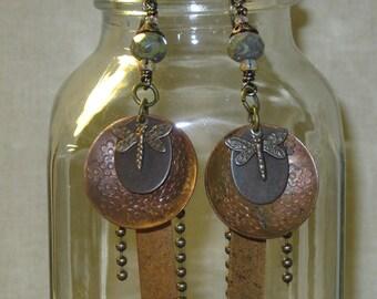Layered brass earrings.