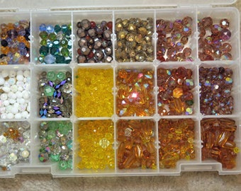 Plastic Box of Many Different Colored and Size Beads.
